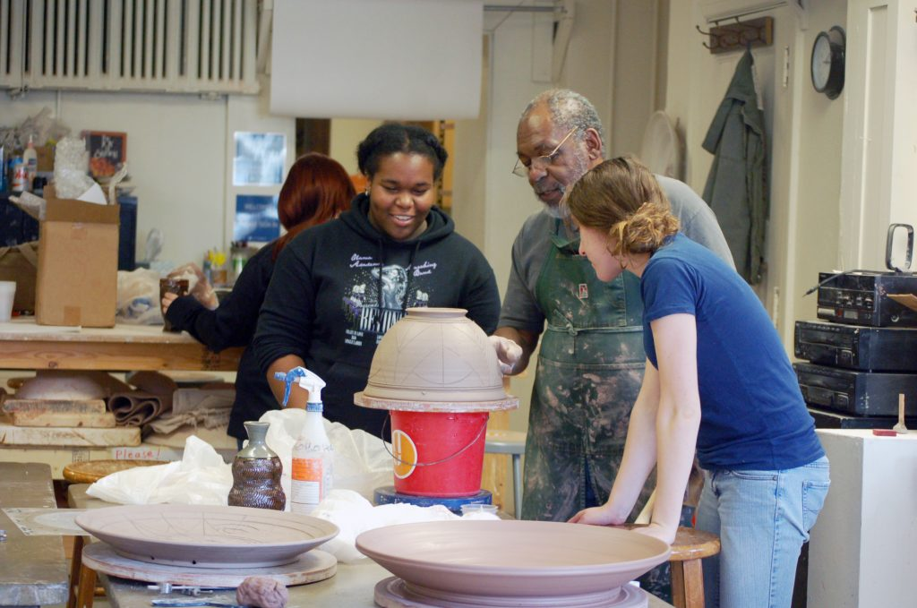 Instructor teaching ceramics class
