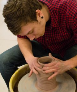 artist working with clay